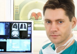 doctor and tomographic scanner in hospital